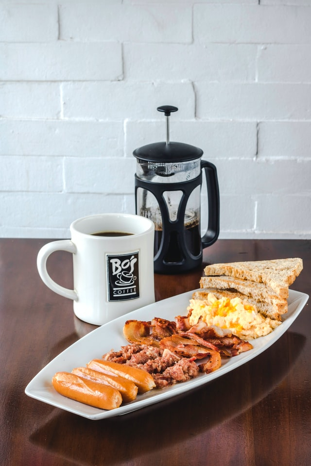 Serve scrambled eggs with sausage or slice of bread and coffee!